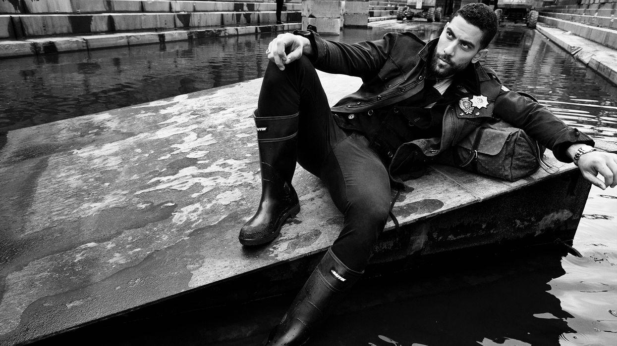 Black and white photo of Zeeko Zaki on a floating dock.