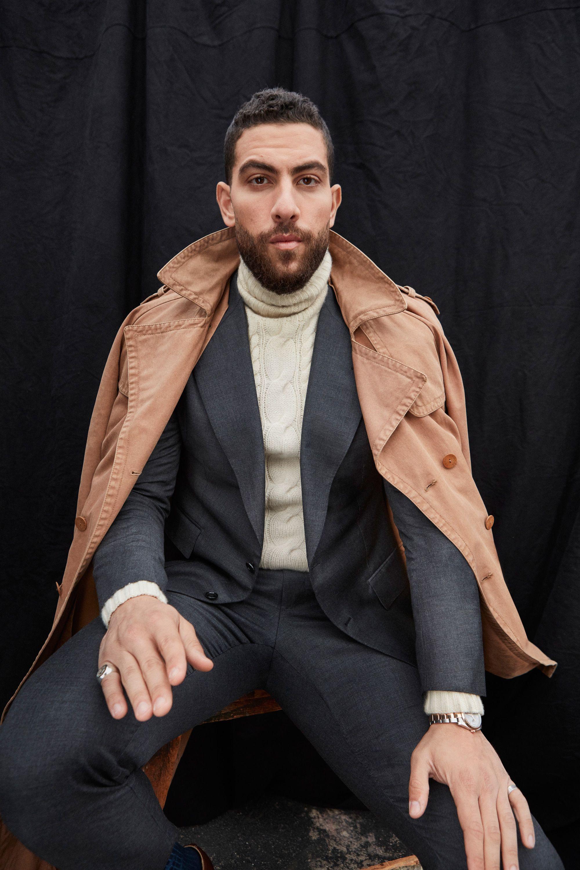 Zeeko Zaki modeling a suit and trench coat.