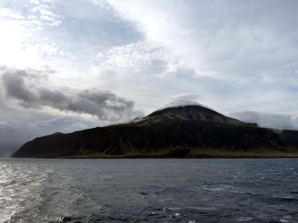Tristan da Cunha from the sea, with Queen Mary's head in the clouds.