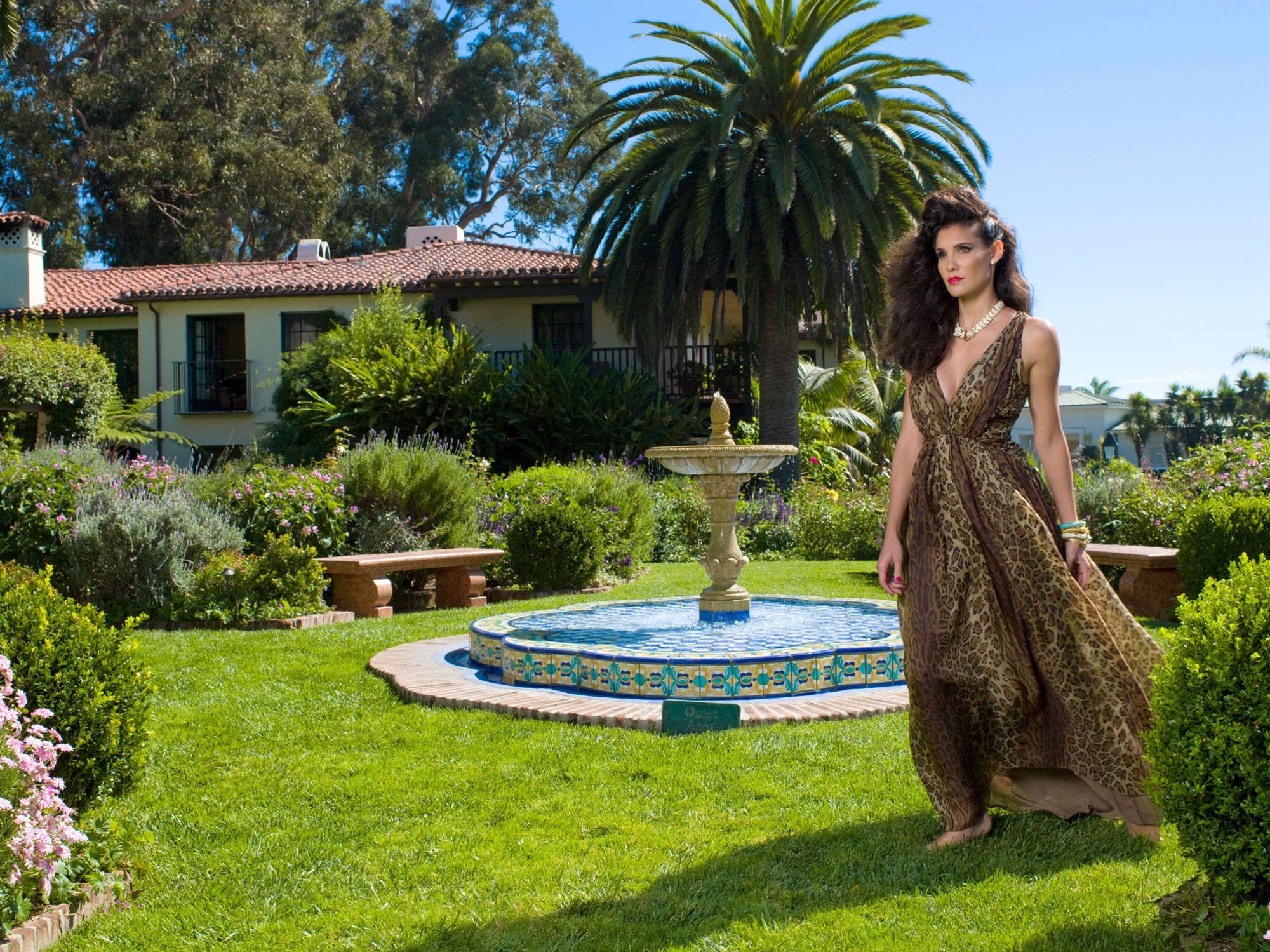 Daniela Ruah of NCIS Los Angeles in animal print gown in garden