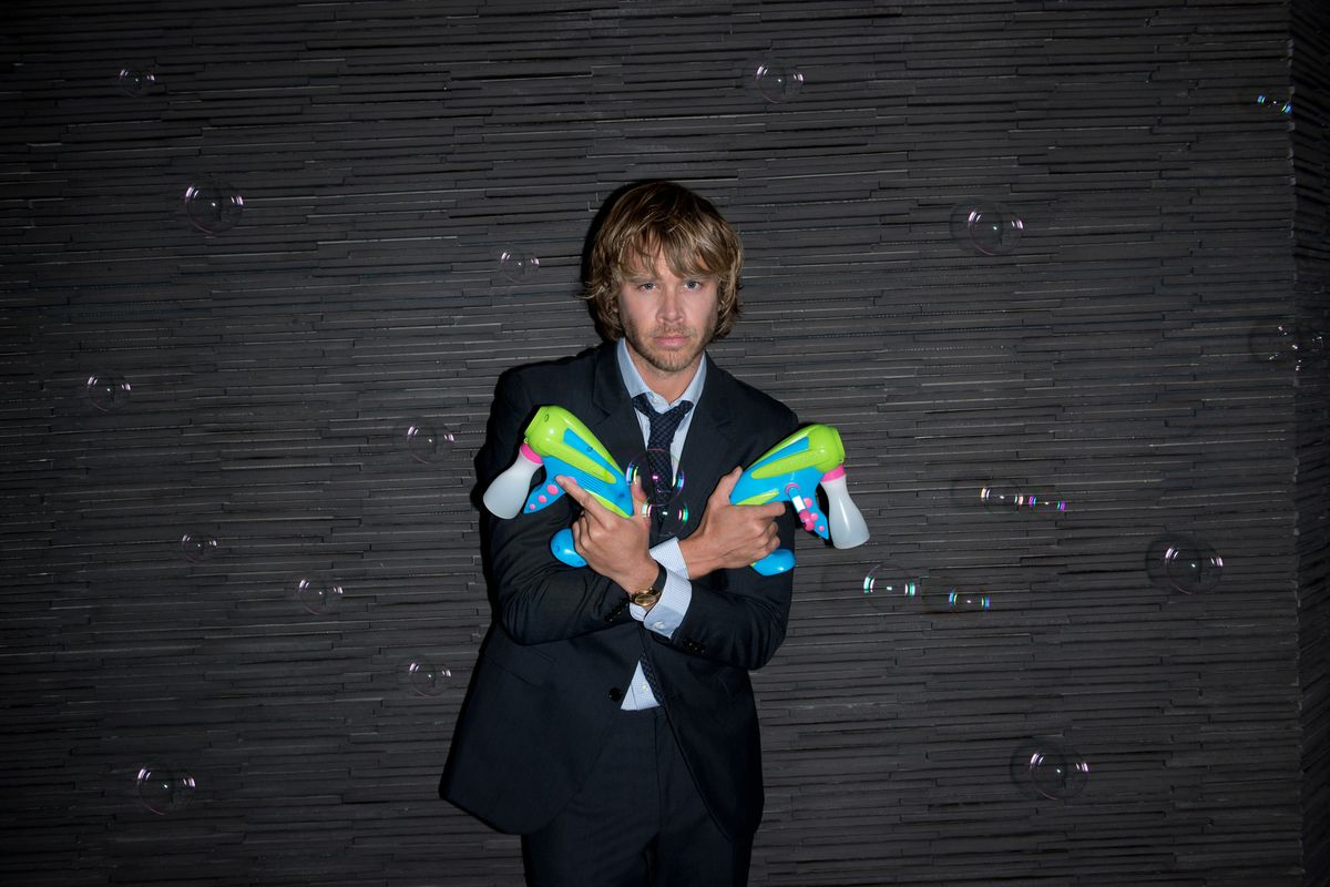 Eric Christian Olsen of NCIS Los Angeles holding bubble guns