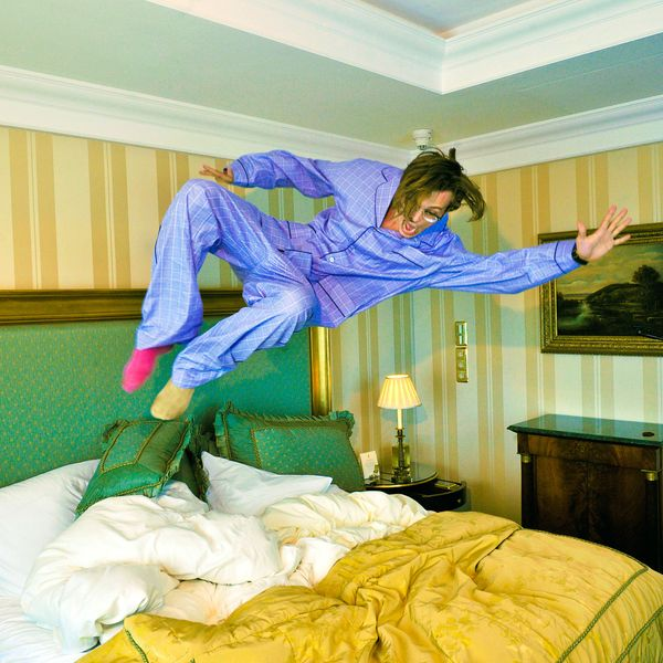 Matthew Gray Gubler in pajamas jumping on bed