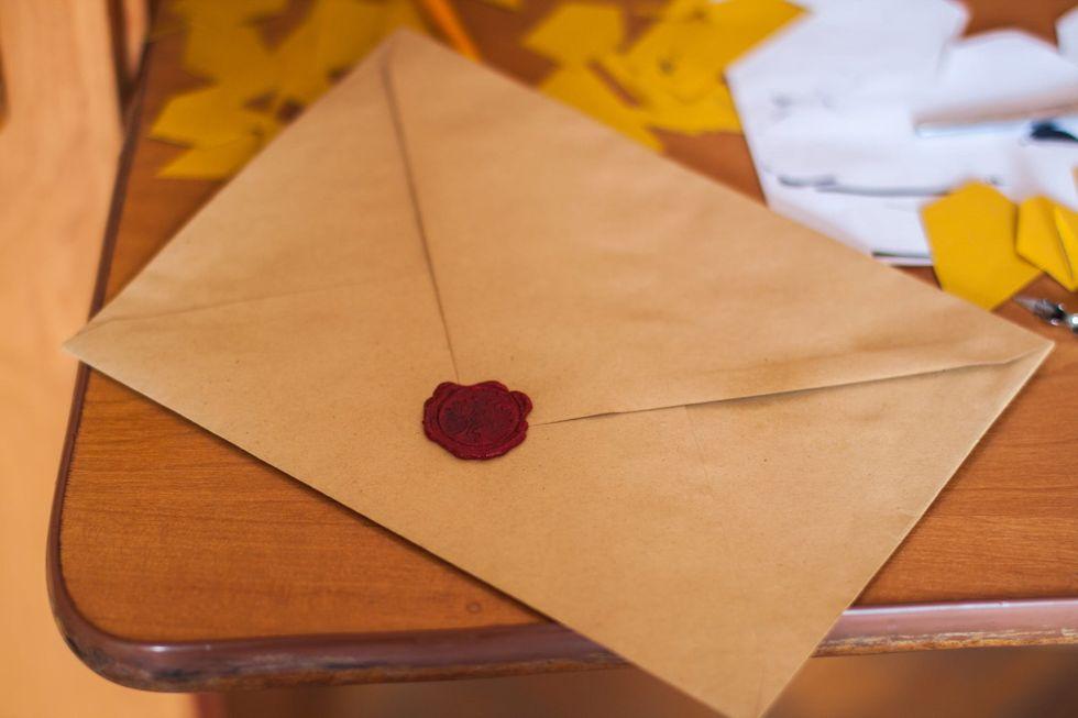 https://www.pexels.com/photo/brown-paper-envelope-on-table-211290/