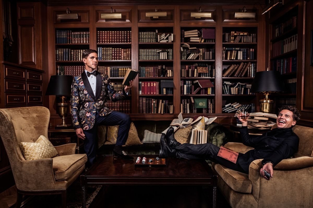 Brian Dietzen of NCIS reading and drinking in a library