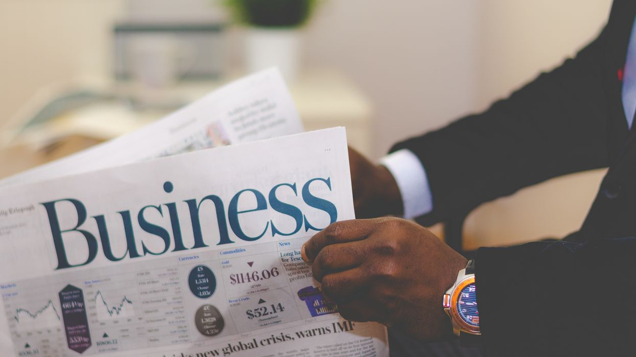 man reading business section of a newspaper