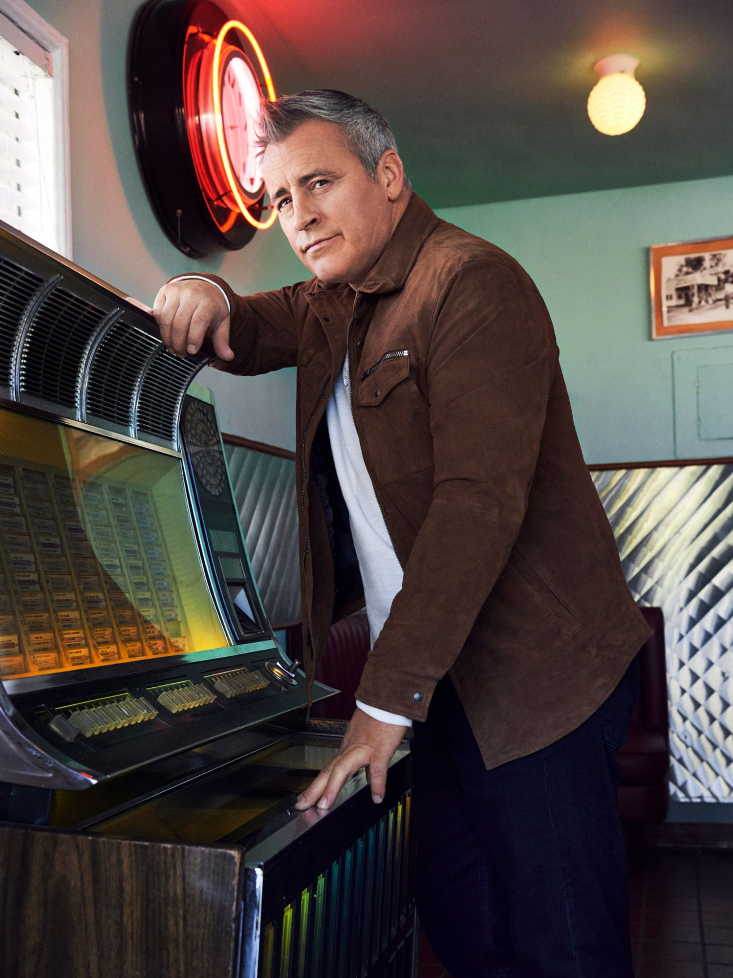 Actor Matt LeBlanc standing at a vintage juke box.