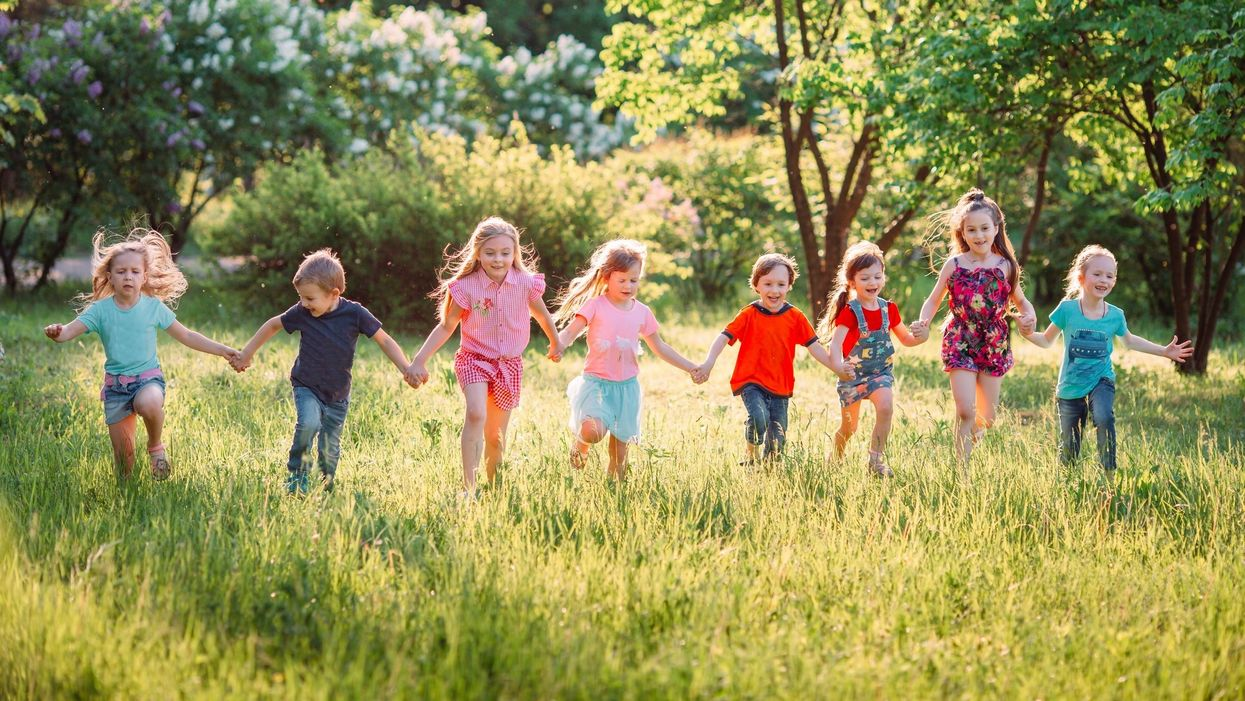 happy children running outside in nature green grass