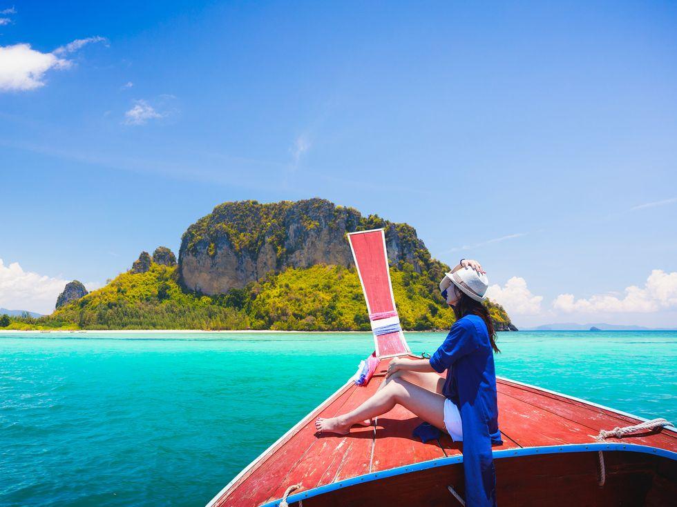 woman boat island travel luxury