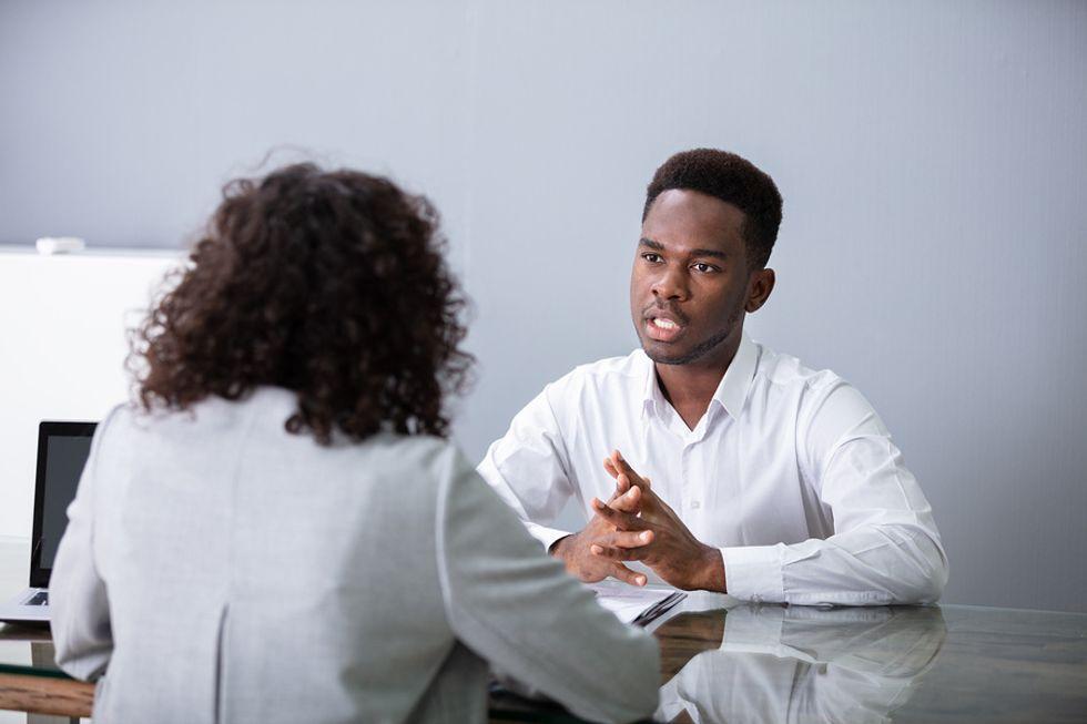 Job seeker answering a behavioral interview question