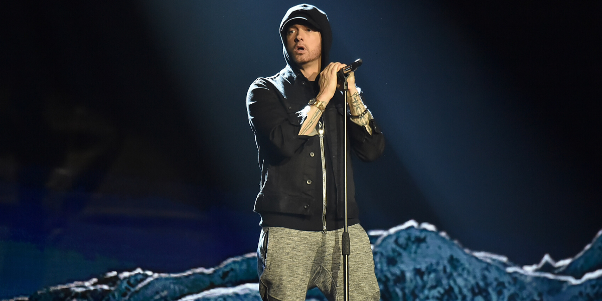 Grindr Just Threw Some Iconic Shade At Eminem's Attempt At The Dolly Parton Challenge