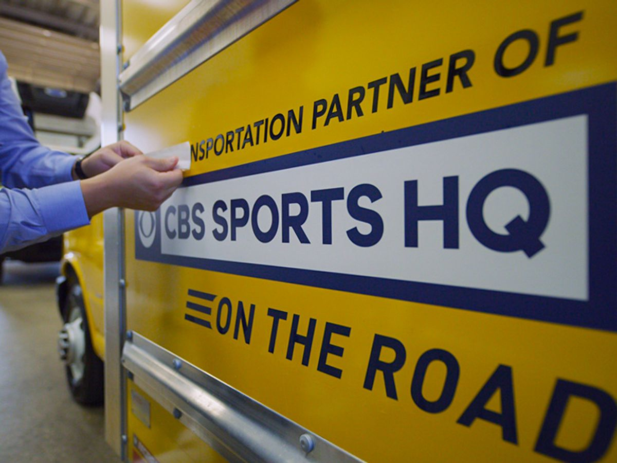 cbs sports hq decal on penske truck