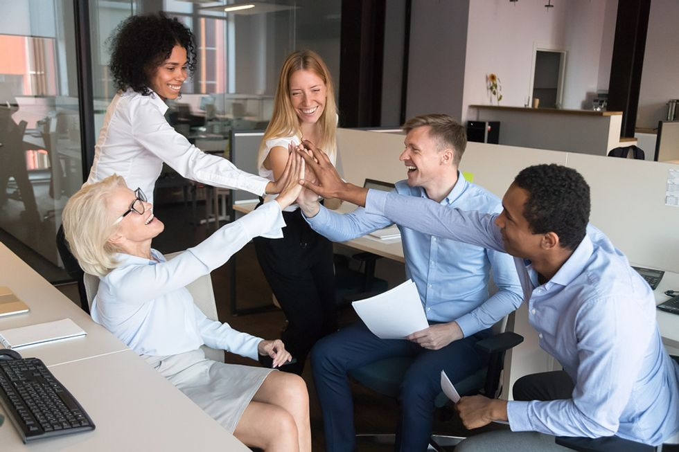 Employees working for a company with great workplace culture