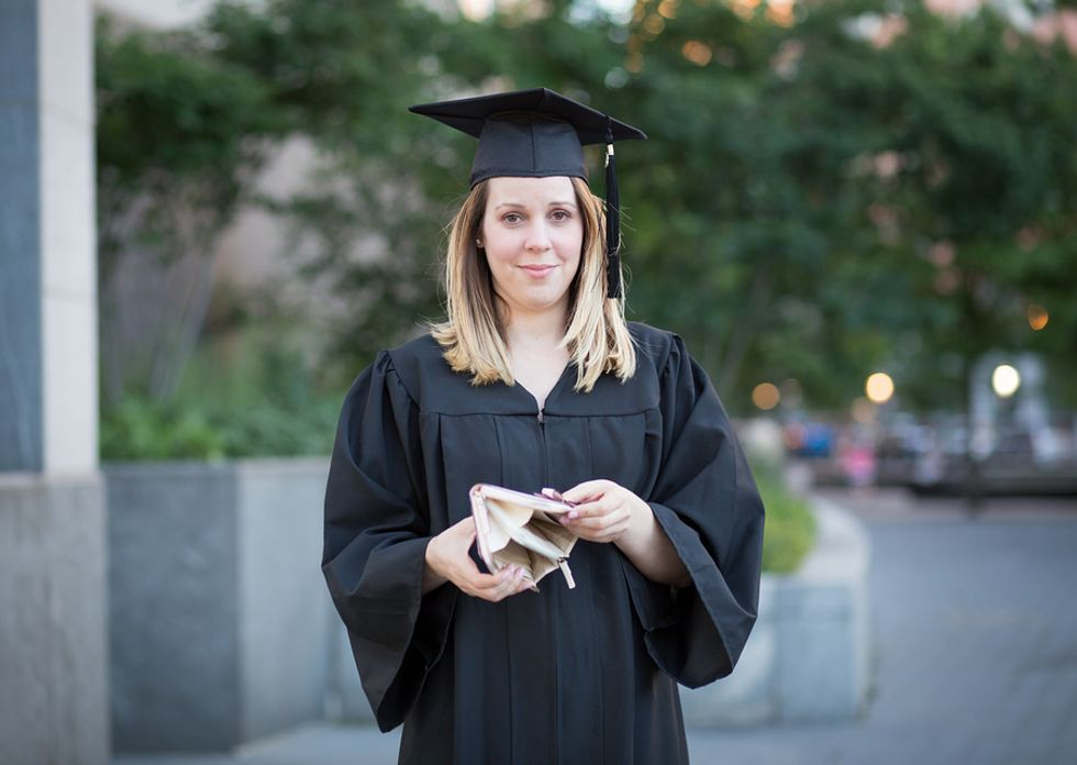 Recent college graduate in debt from earning a degree