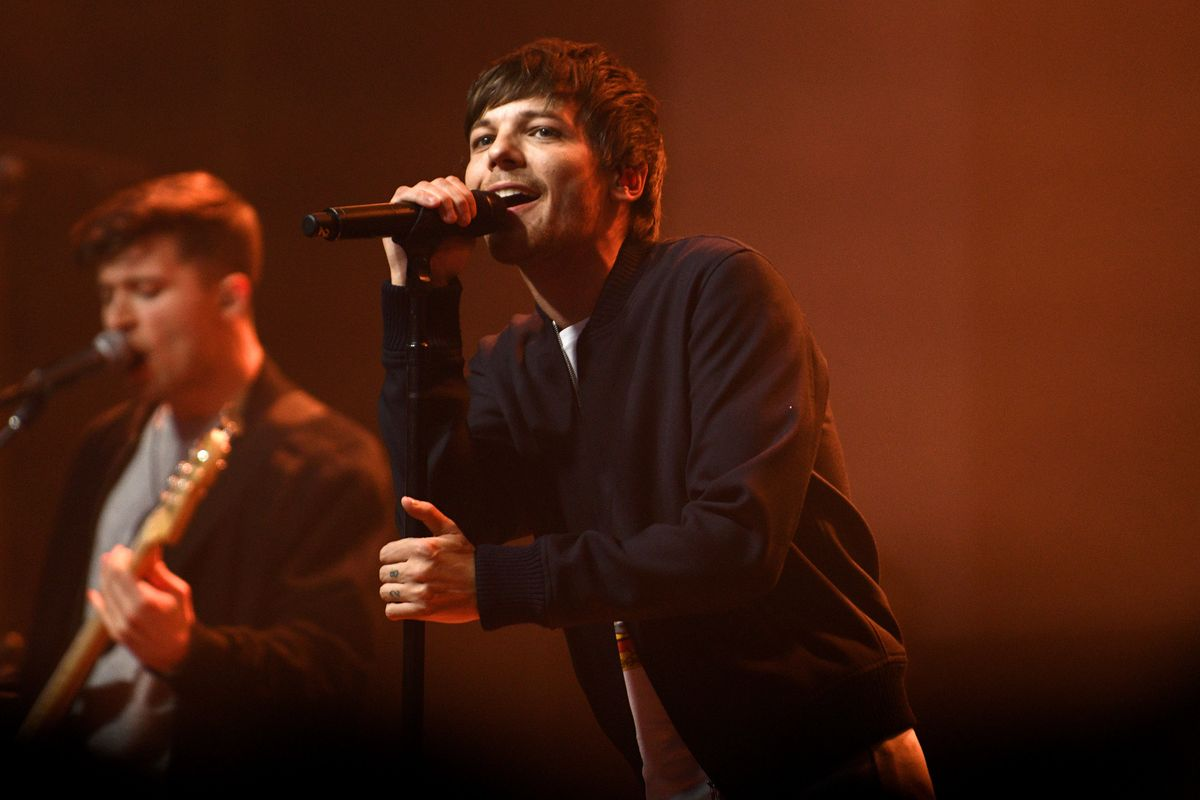Louis Tomlinson Isn't Beefing With the One Direction Boys