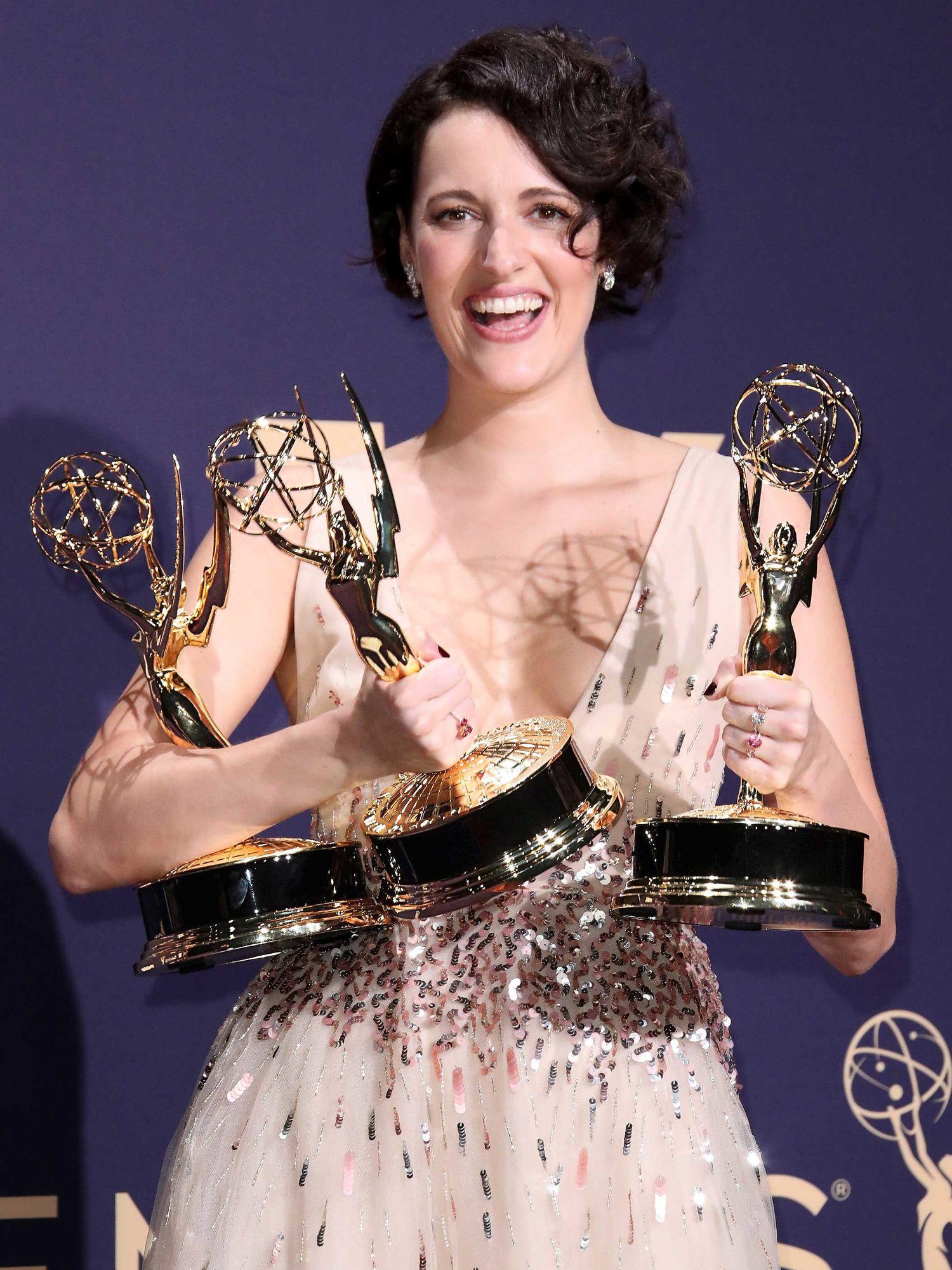 Phoebe Waller-Bridge holding Emmy Award wins.