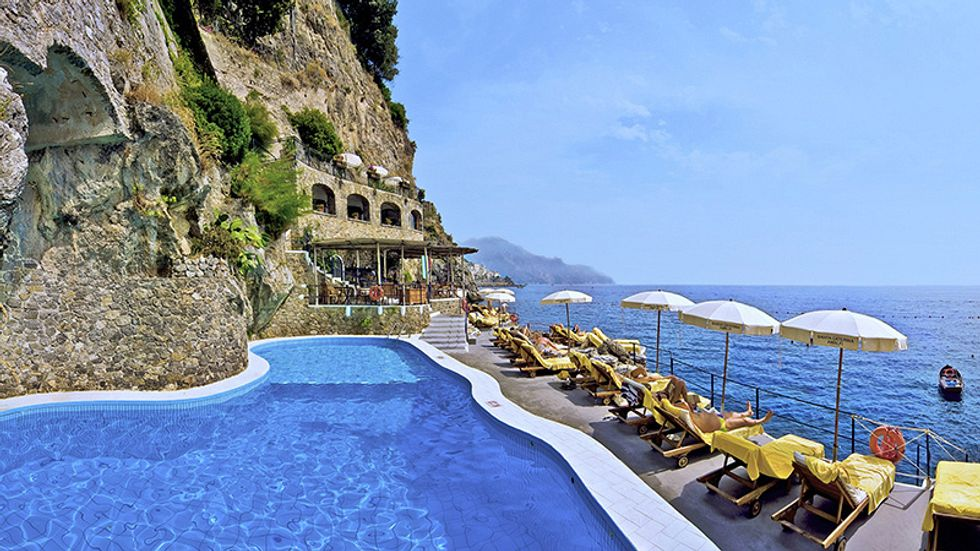 A view of the ocean from poolside at the Hotel Santa Caterina.