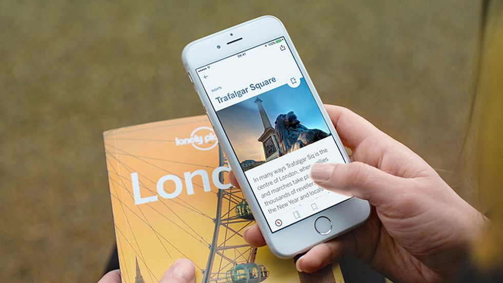 A travel guide and an iPhone.