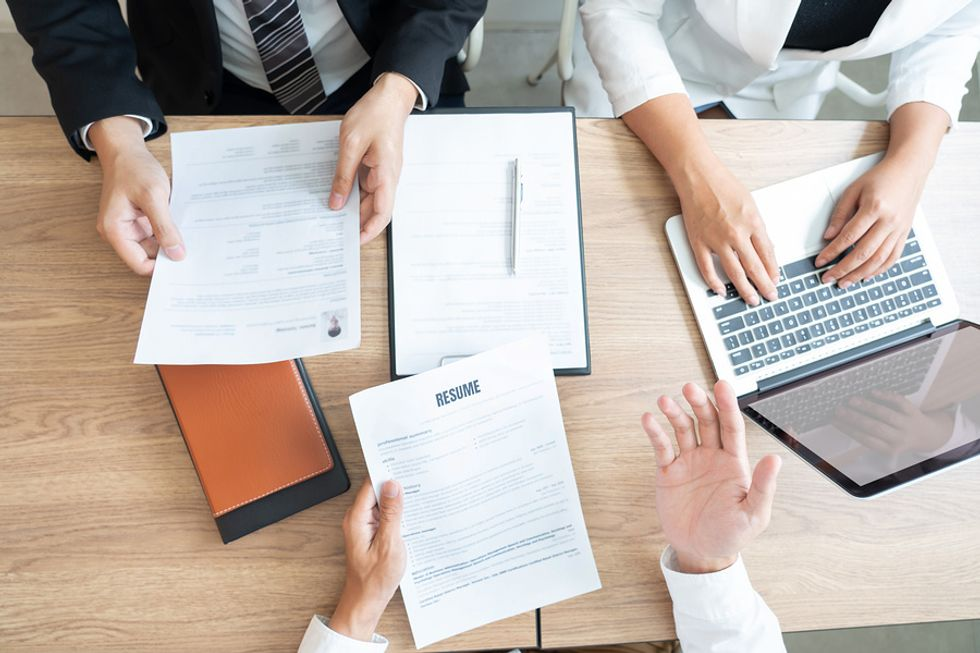 Hiring managers discuss a job candidate with a well-written resume