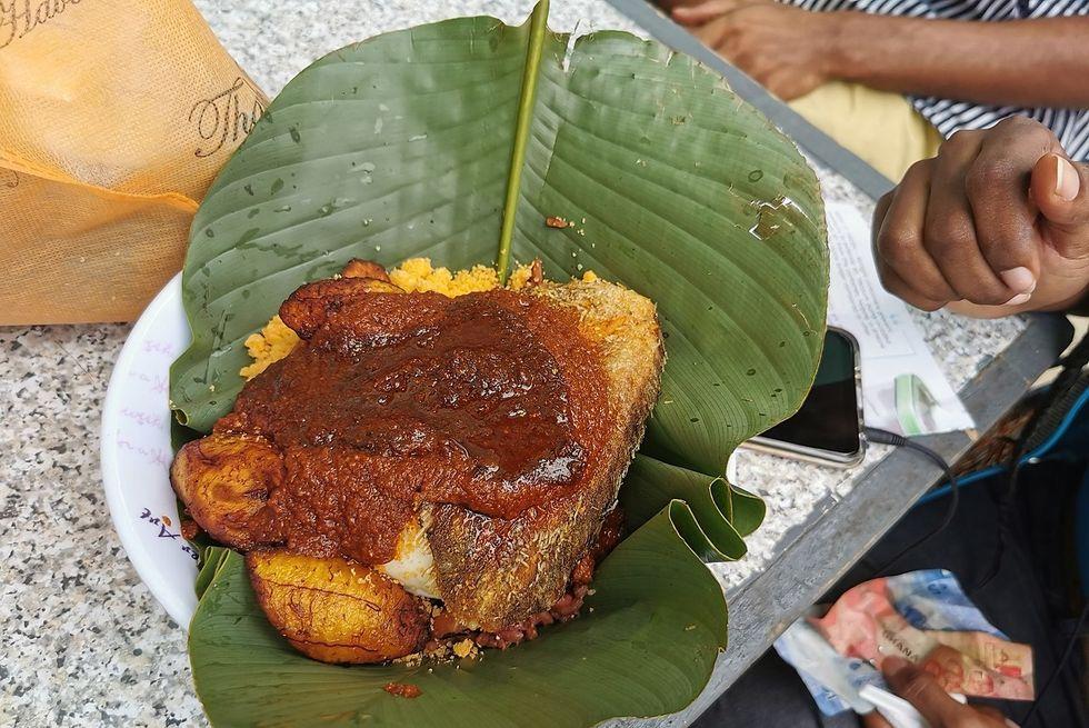Waakye, Ghanaian food served in a leaf.