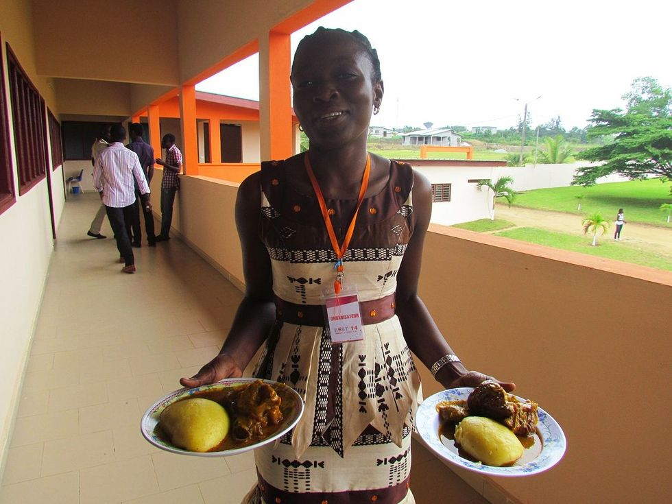 Woman serving foutou in Ivory Coast.