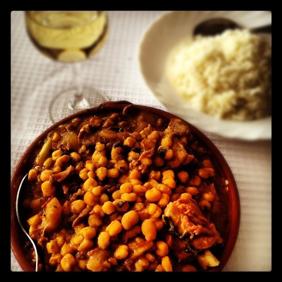 Cachupa is a traditional Cape Verdean stew served here with white wine.