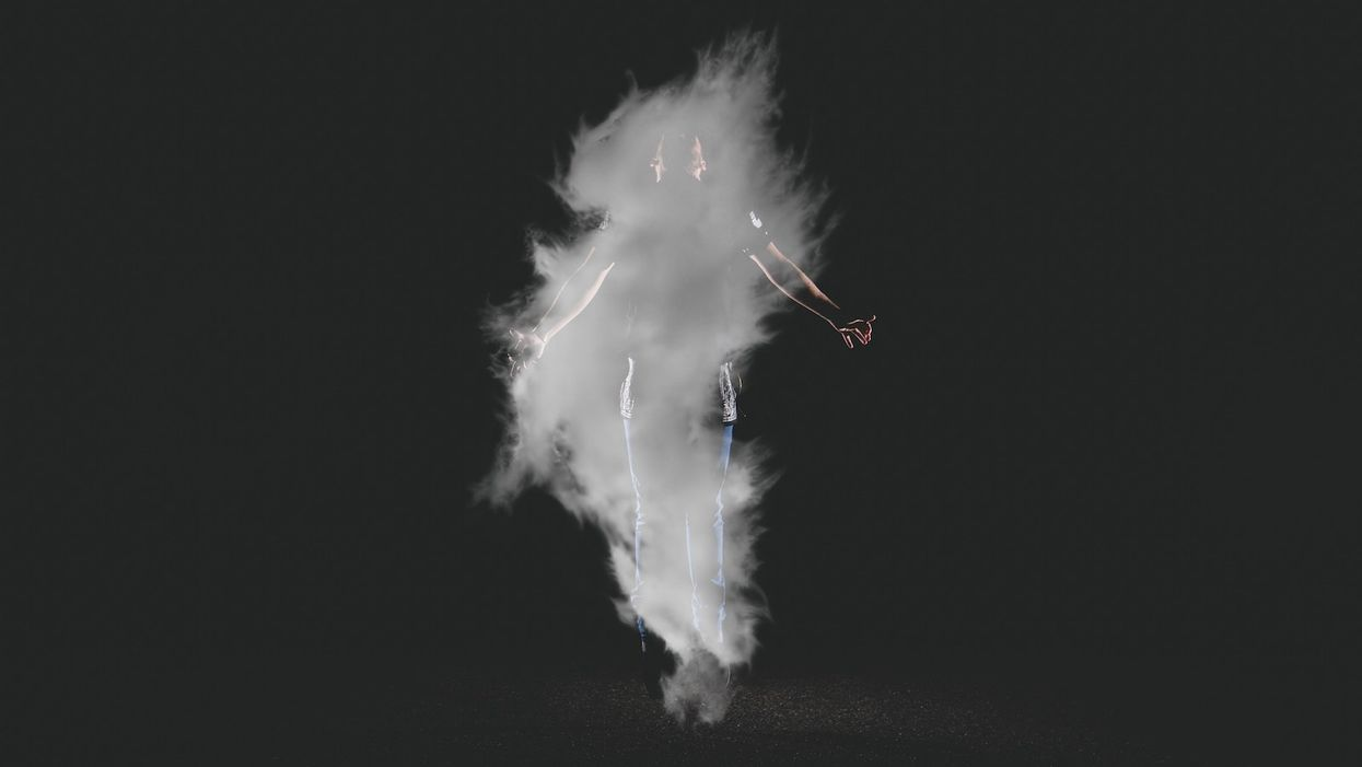 man floating in a cloud of smoke