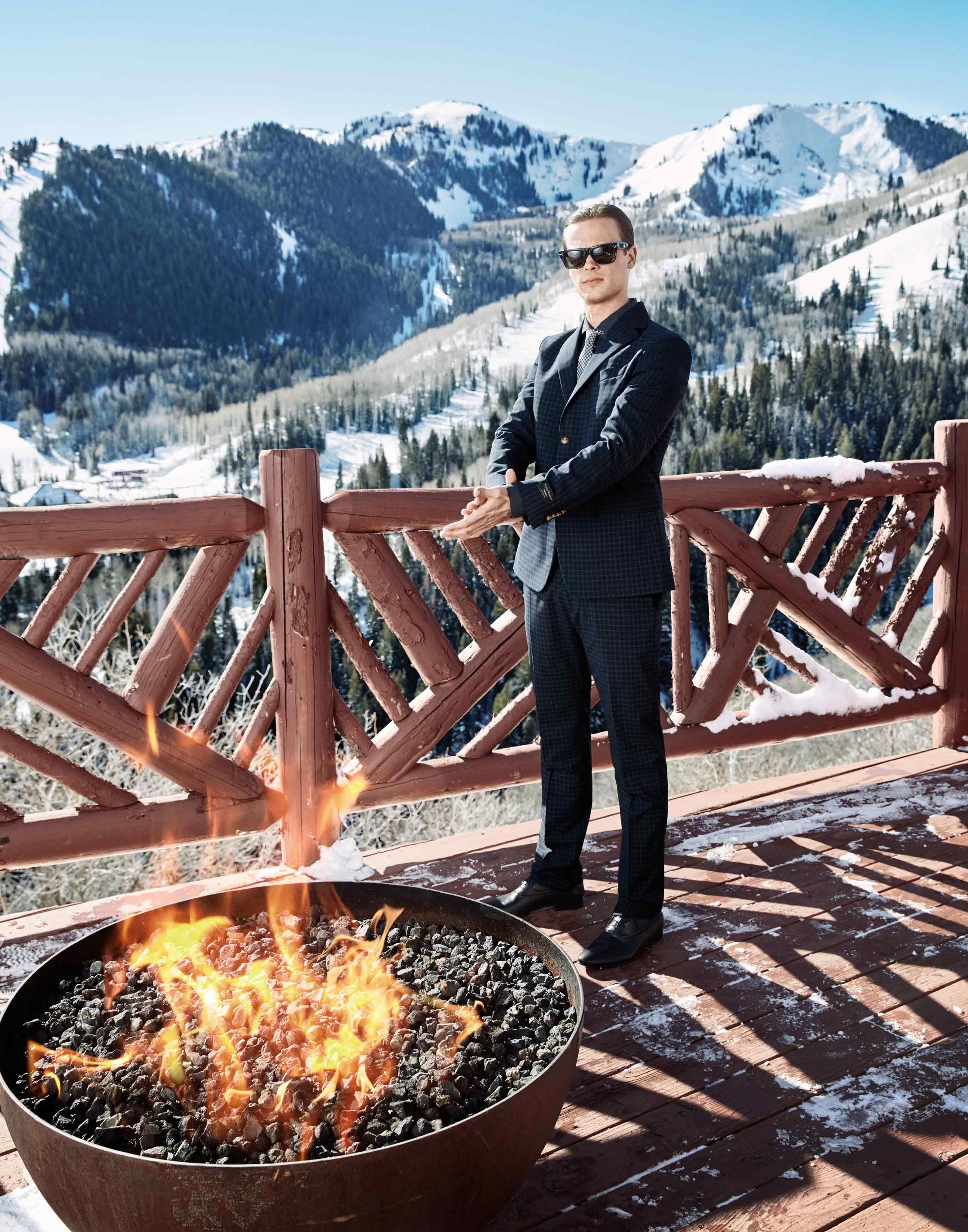 Matthew Gray Gubler outside in front of a fire pit in Utah