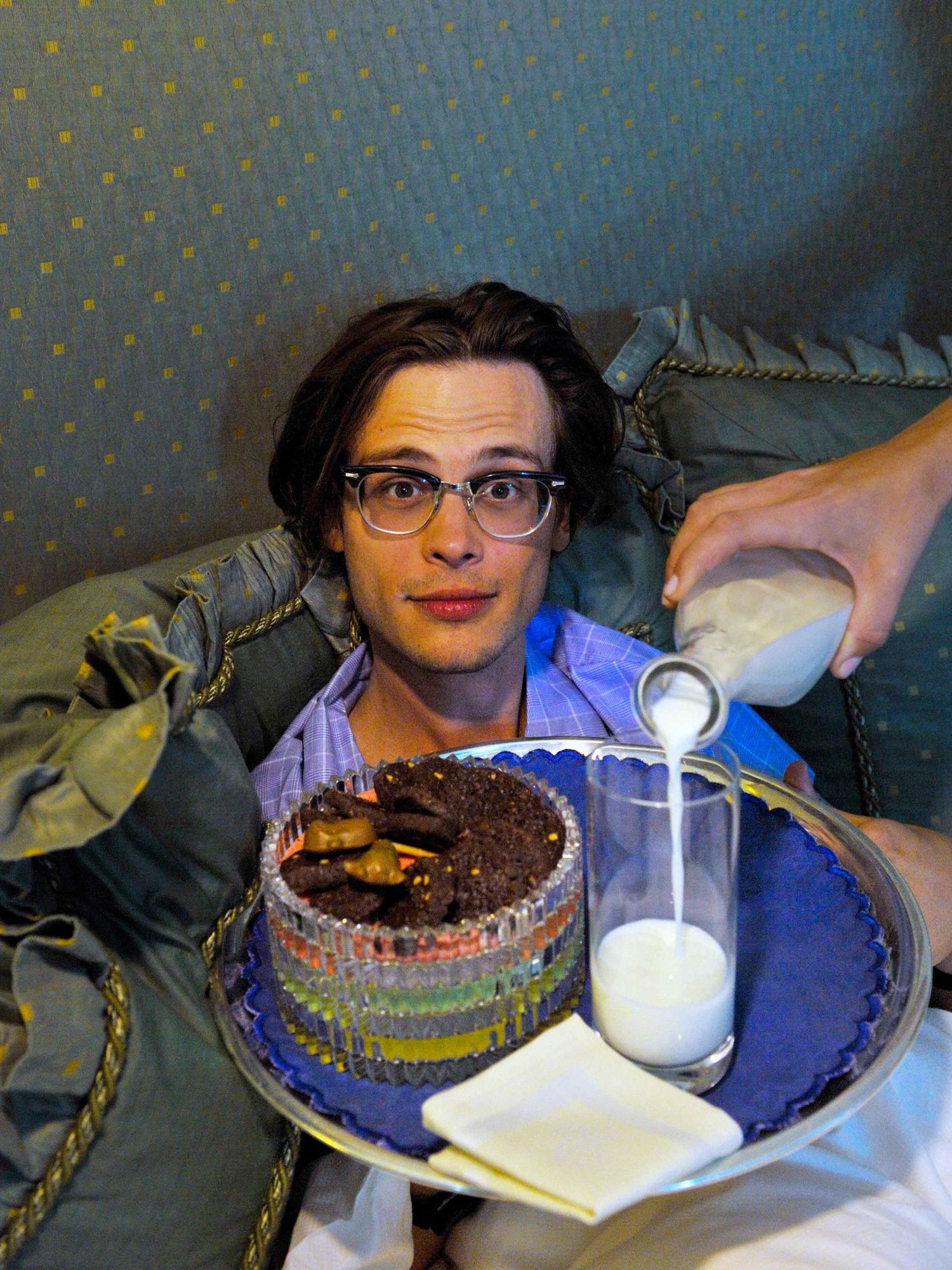 Matthew Gray Gubler being served milk and cookies