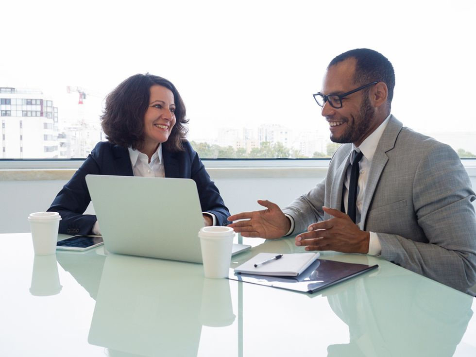 A career coach works with a client on their resume