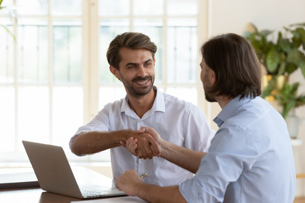 Man shakes hands with his career coach