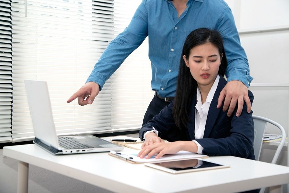 Woman experiences physical harassment in the workplace