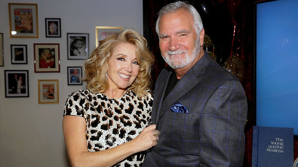 Melody Thomas Scott standing with John McCook for a picture