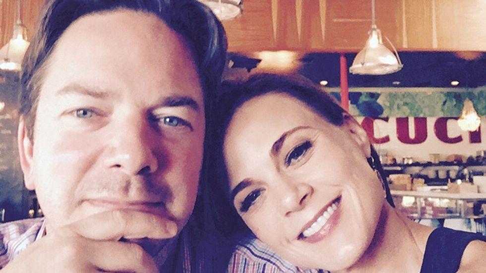 Gina Tognoni and husband take a selfie in a deli.