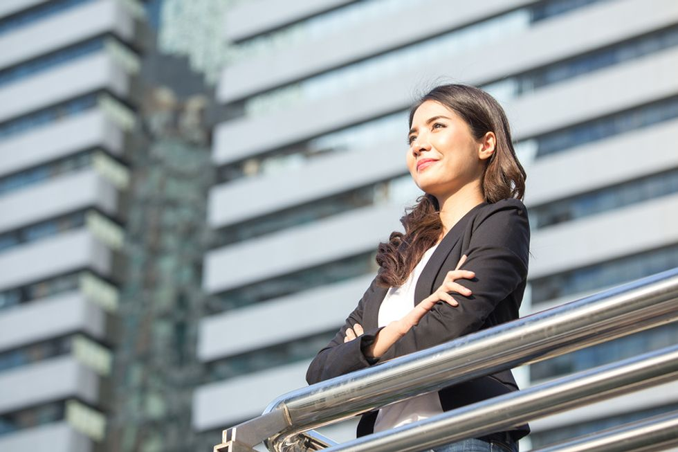 Professional woman thinking about what she wants to achieve in her career
