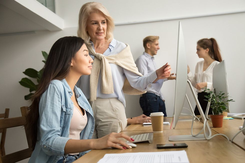 Senior employee trains a new employee to help her grow in her career