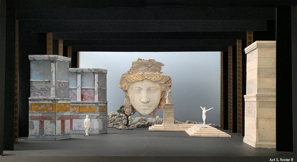 Set design featuring abstracted Greek stone ruins.