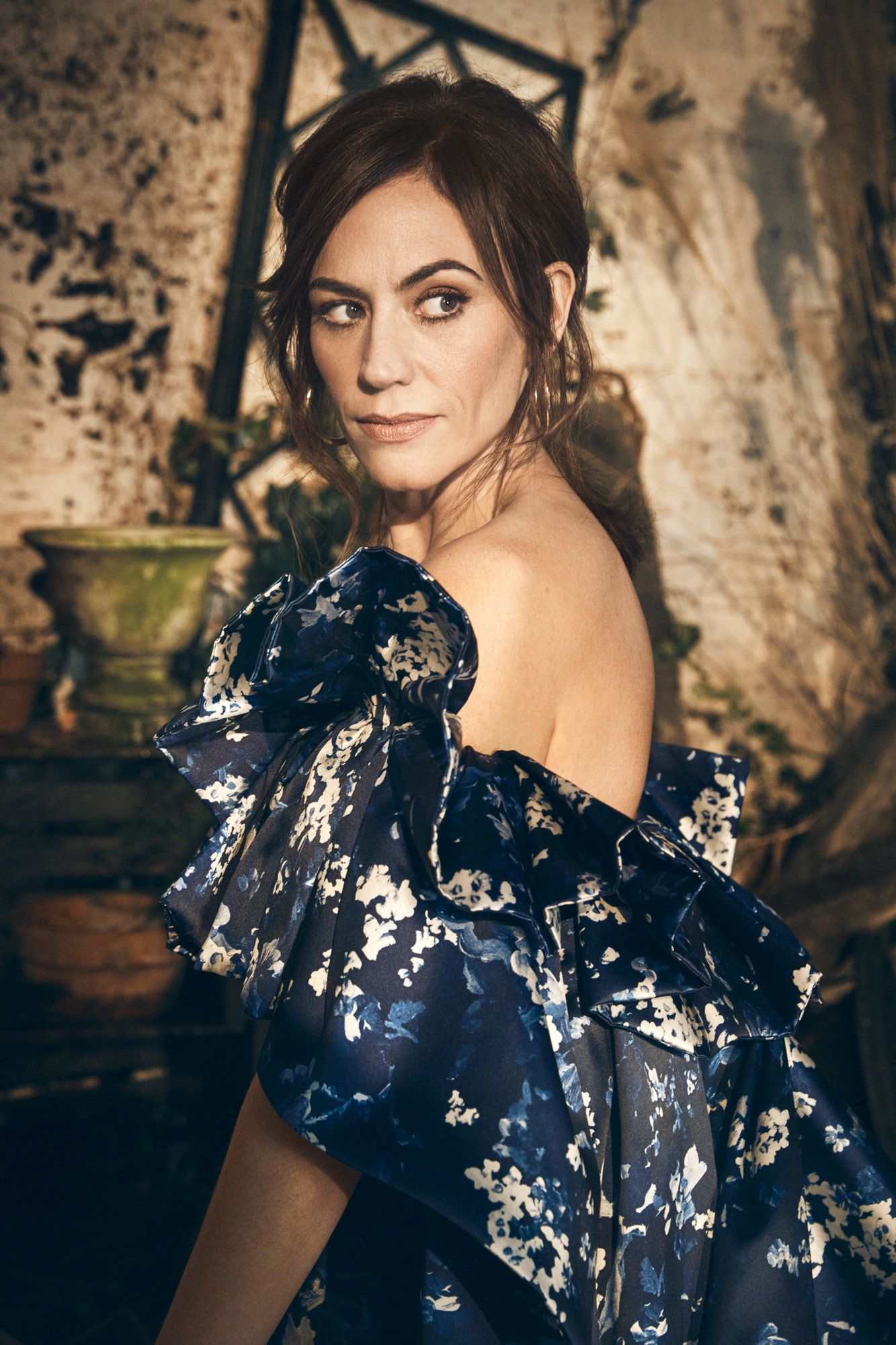 Maggie Siff in a blue floral gown.