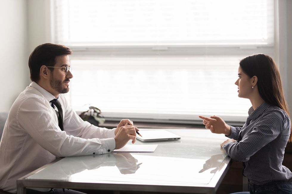 Woman prepares for the interview process with a mock interview