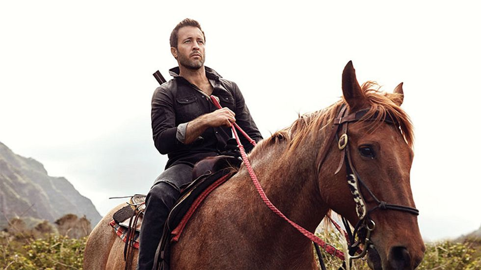 Alex O'Loughlin wears a leather jacket and pants while riding horseback.