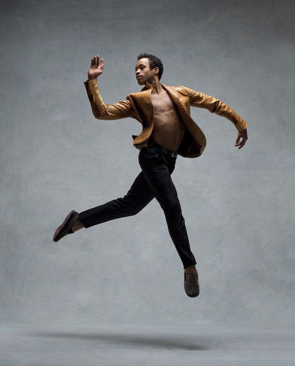 Gabe Stone Shayer leaps easily on a grey backdrop