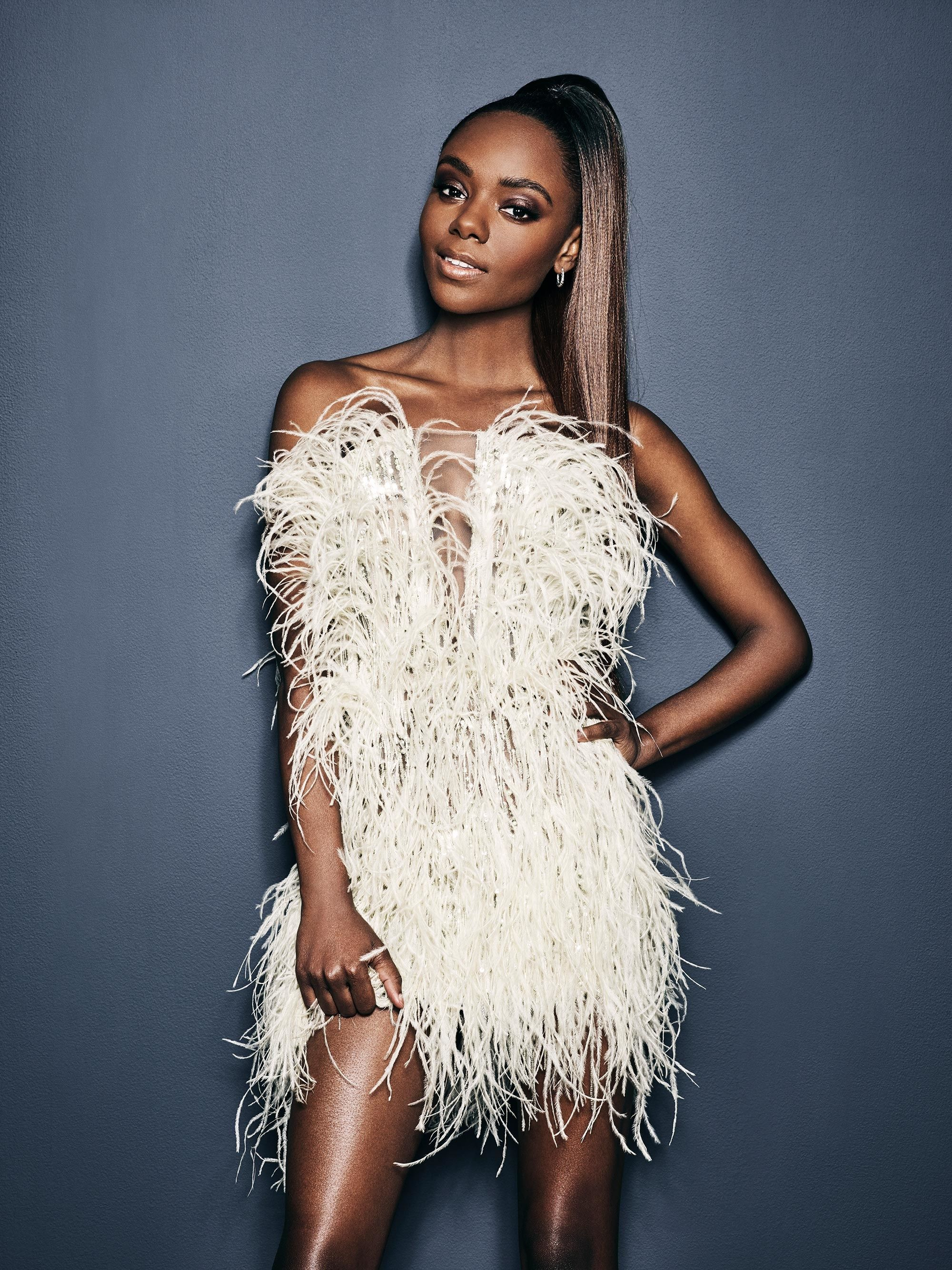 Ashleigh Murray in a white feather dress.
