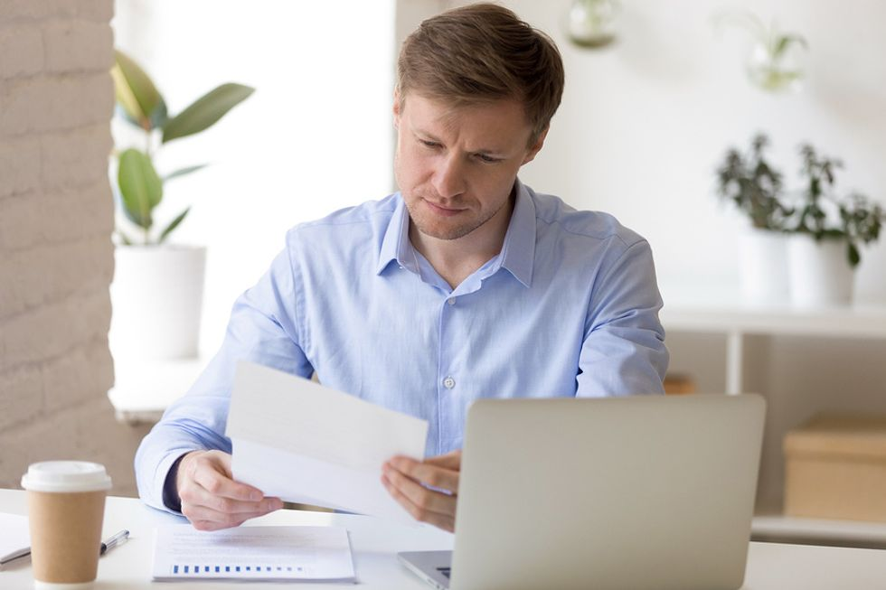 Man updates his resume before updating his LinkedIn profile