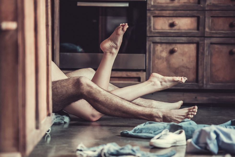 concept of sex naked couple with clothes on the floor