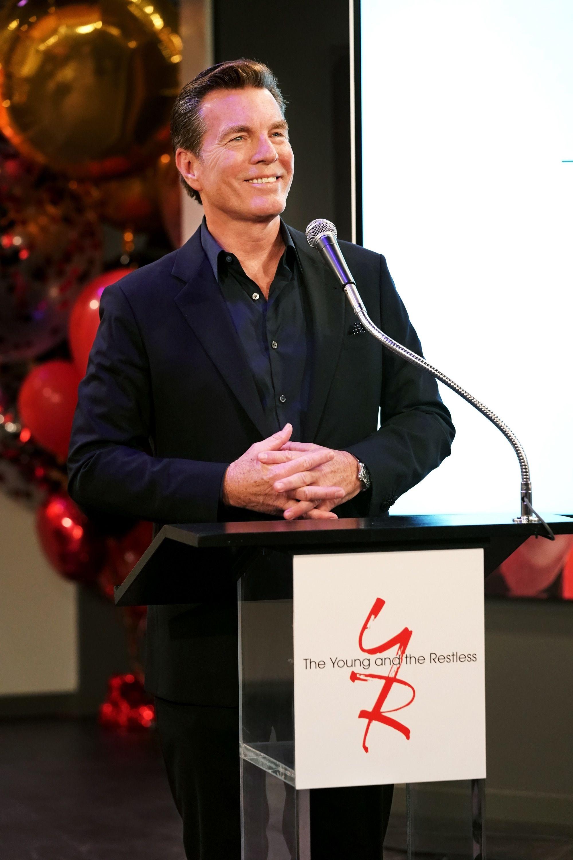 Peter Bergman at a podium giving a speech.