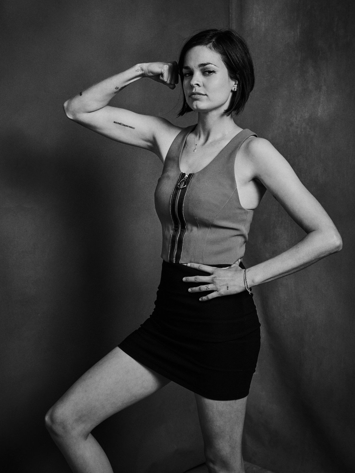 Lina Esco of S.W.A.T. flexing her muscles.
