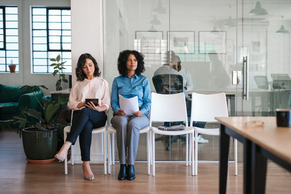 Two working women wait for a job interview