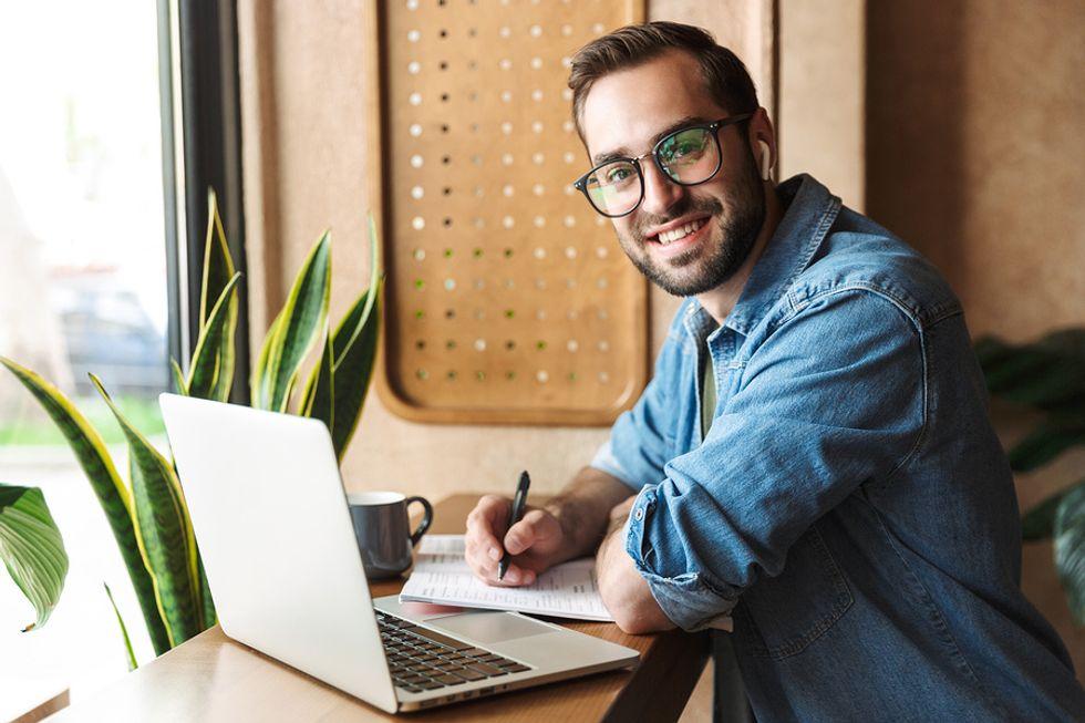 Man writes down quantifiable accomplishments on his resume