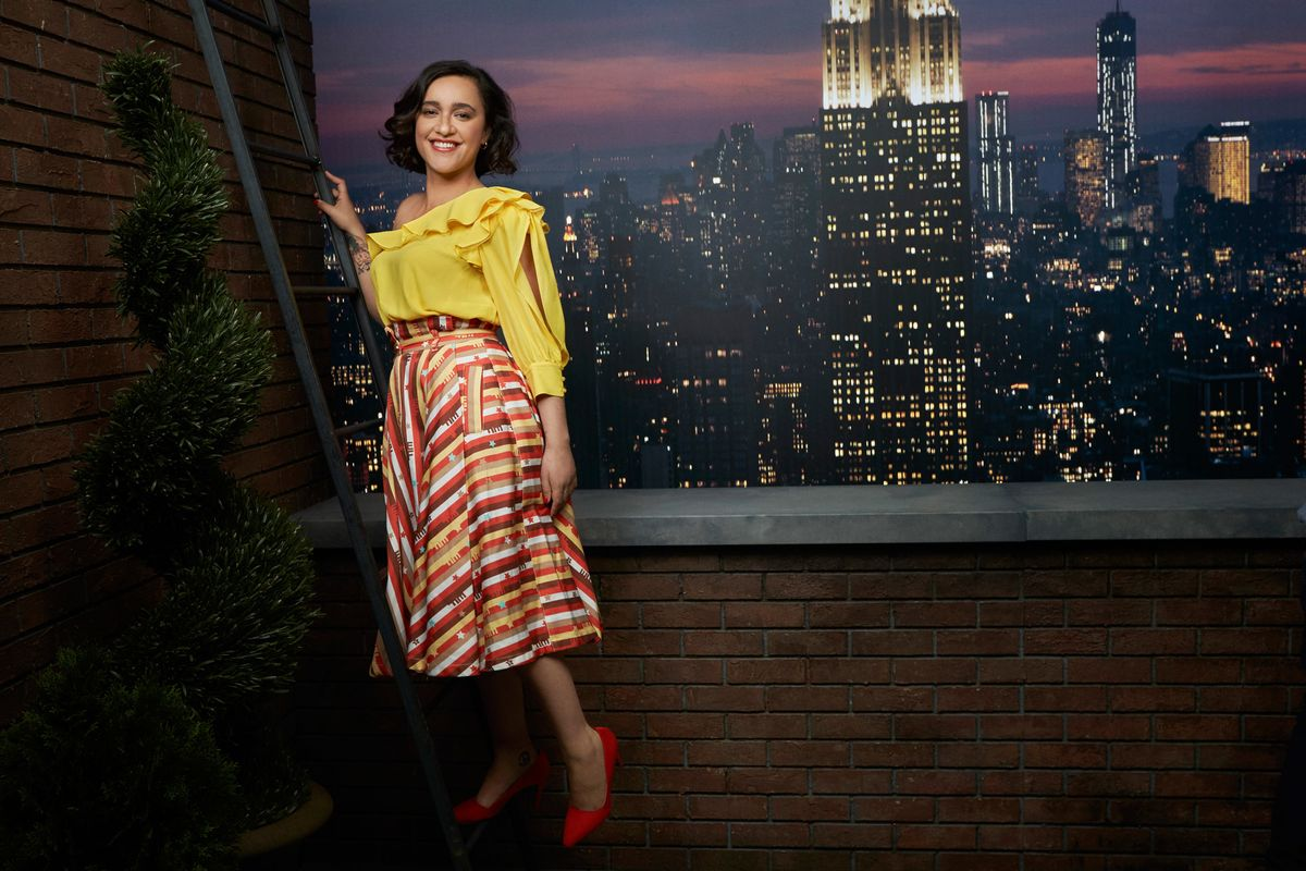 Keisha Castle-Hughes posing in front of a Manhattan skyline backdrop.