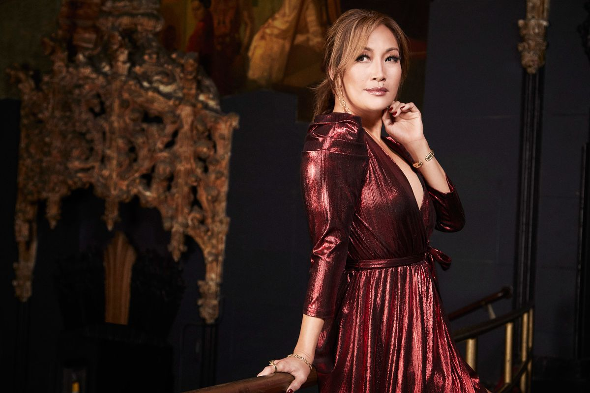 Carrie Ann Inaba of The Talk in a maroon dress.