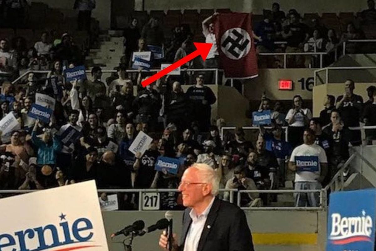 A white supremacist unfurled a giant Nazi flag and yelled 'Heil Hitler' at a Bernie Sanders rally